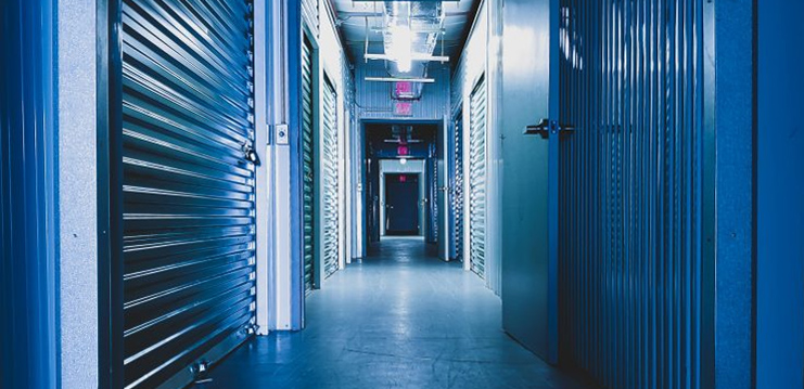 The hallway with blue storage units