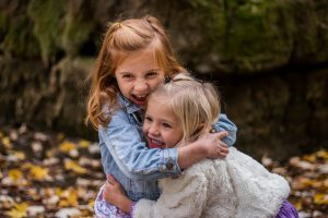 Two girls hugging each other
