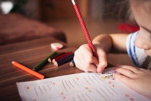 Close up of a girl writing in a notebook