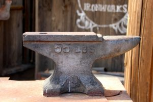 Organize your storage unit like a pro: anvil on a table