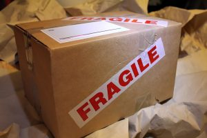 "A box with a ""FRAGILE"" label on its side"
