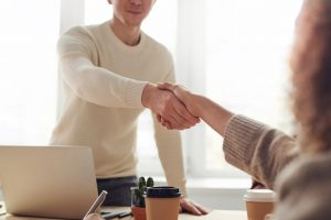 Shaking hands when hiring Delray Beach movers