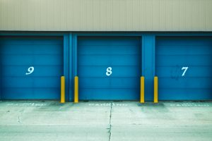 three storage units with numbers on them